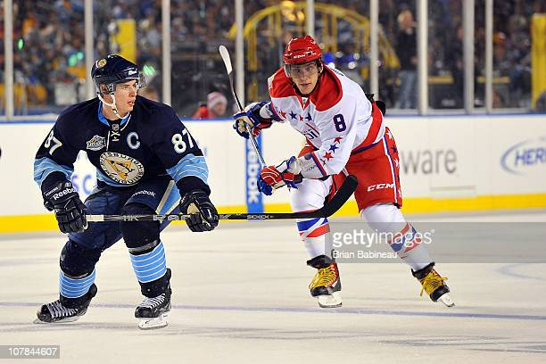Sidney Crosby of the Pittsburgh Penguins skates against Alex Ovechkin of the Washington Capitals during the 2011 NHL Bridgestone Winter Classic at...