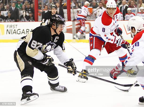 Sidney Crosby of the Pittsburgh Penguins skates against Alex Ovechkin of the Washington Capitals during the game at Consol Energy Center on March 11...