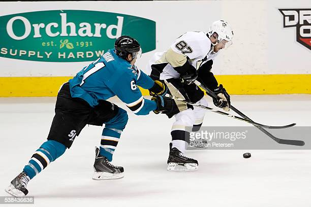 Sidney Crosby of the Pittsburgh Penguins skates against Justin Braun of the San Jose Sharks during the first period in Game Four of the 2016 NHL...