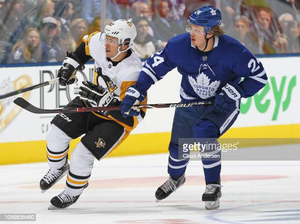 Sidney Crosby of the Pittsburgh Penguins skates against Kasperi Kapanen of the Toronto Maple Leafs during an NHL game at Scotiabank Arena on October...