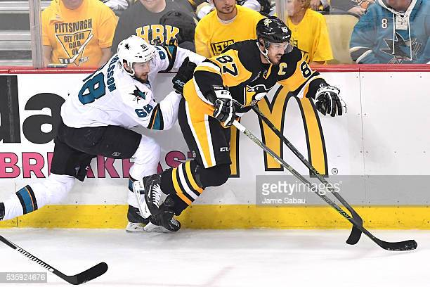 Sidney Crosby of the Pittsburgh Penguins skates against Melker Karlsson of the San Jose Sharks during the first period in Game One of the 2016 NHL...