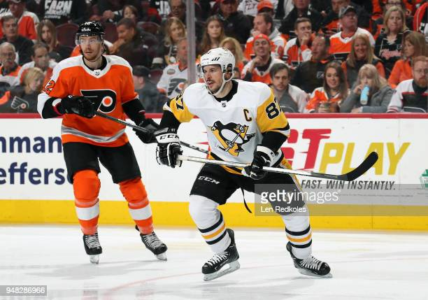Sidney Crosby of the Pittsburgh Penguins skates against Michael Raffl of the Philadelphia Flyers in Game Three of the Eastern Conference First Round...