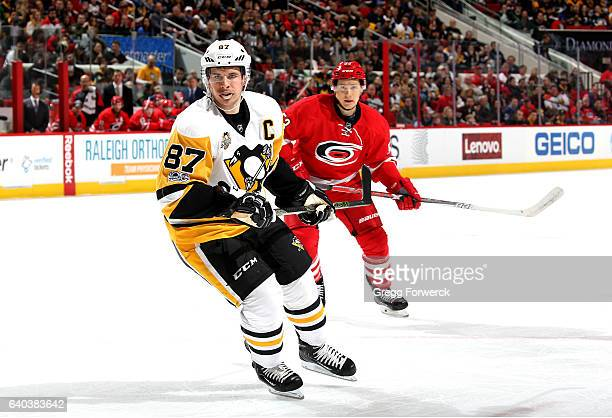 Sidney Crosby of the Pittsburgh Penguins skates for position on the ice ahead of Jeff Skinner of the Carolina Hurricanes during an NHL game on...