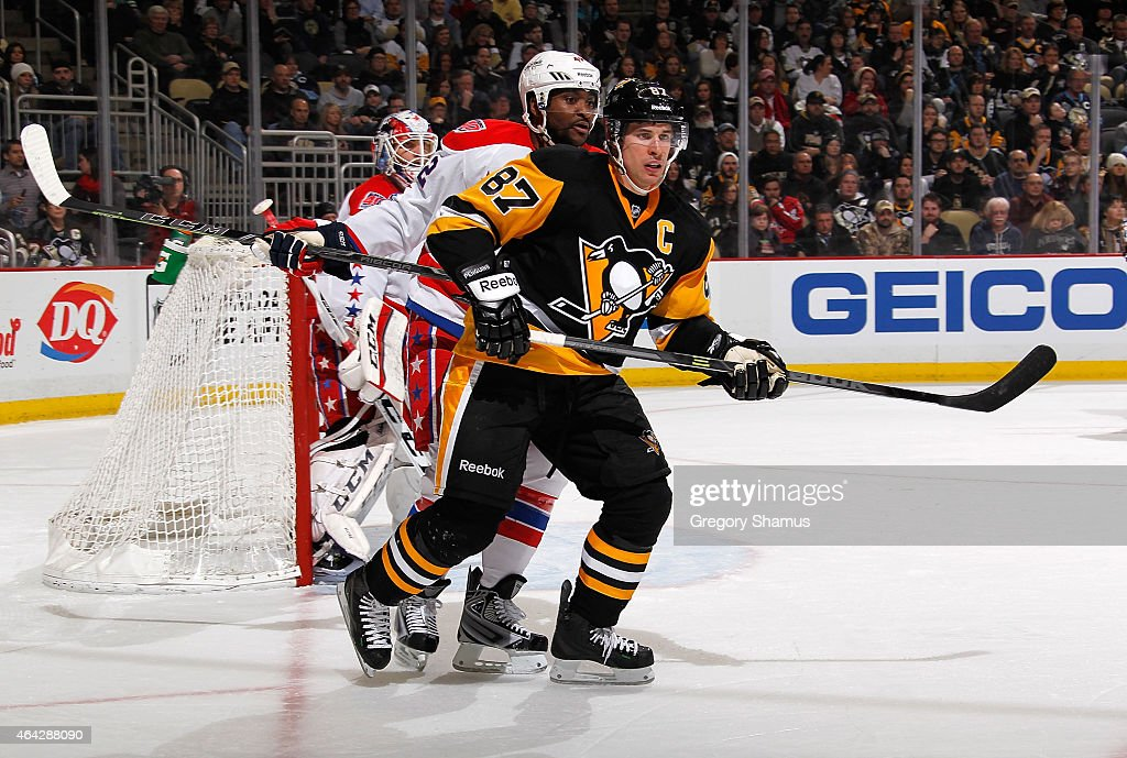 Sidney Crosby #87 of the Pittsburgh Penguins skates in front of Joel Ward #42 of the Washington Capitals at Consol Energy Center on February 17, 2015 in Pittsburgh, Pennsylvania.