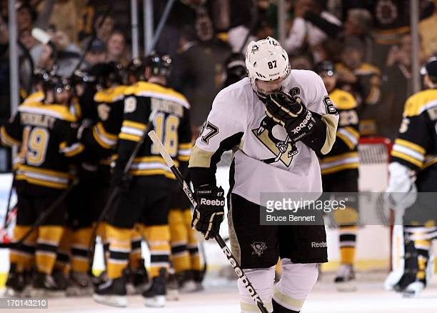 Sidney Crosby of the Pittsburgh Penguins skates off the ice after being defeated by the Boston Bruins 1-0 in Game Four of the Eastern Conference...
