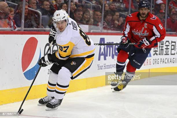 Sidney Crosby of the Pittsburgh Penguins skates past Alex Ovechkin of the Washington Capitals during the second period at Capital One Arena on...