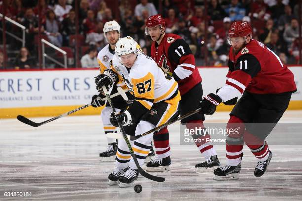 Sidney Crosby of the Pittsburgh Penguins skates with the puck ahead of Martin Hanzal of the Arizona Coyotes during the third period of the NHL game...