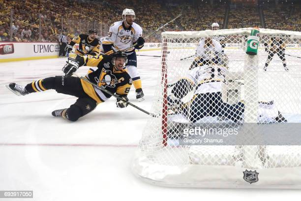 Sidney Crosby of the Pittsburgh Penguins slides in front of Pekka Rinne of the Nashville Predators in the first period in Game Five of the 2017 NHL...