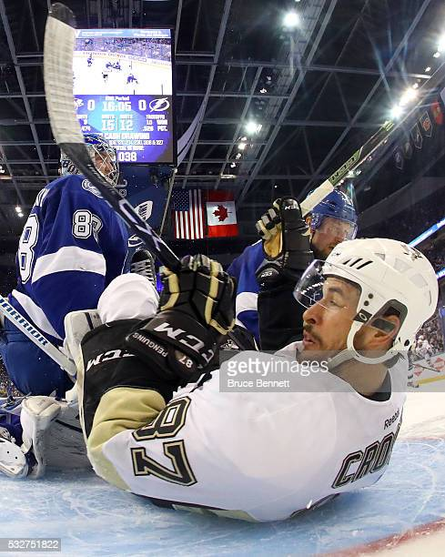 Sidney Crosby of the Pittsburgh Penguins slides in the Tampa Bay Lightning net after a play during the second period in Game Three of the Eastern...
