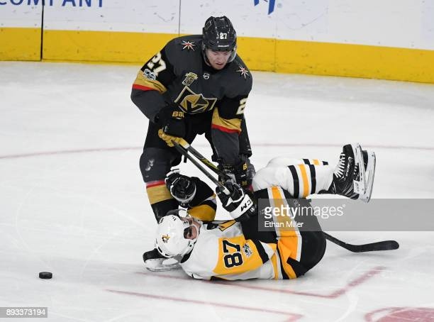 Sidney Crosby of the Pittsburgh Penguins slides into Shea Theodore of the Vegas Golden Knights in the second period of their game at TMobile Arena on...