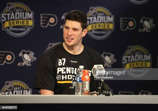 Sidney Crosby of the Pittsburgh Penguins speaks to the meia after his practice session for the 2017 Coors Light NHL Stadium Series game to be played...