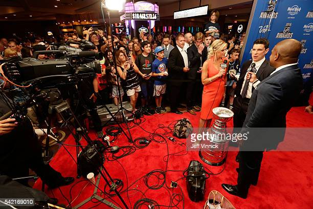 Sidney Crosby of the Pittsburgh Penguins speaks with NHL Network hosts Kevin Weekes and Kathryn Tappen as he arrives for the 2016 NHL Awards at the...