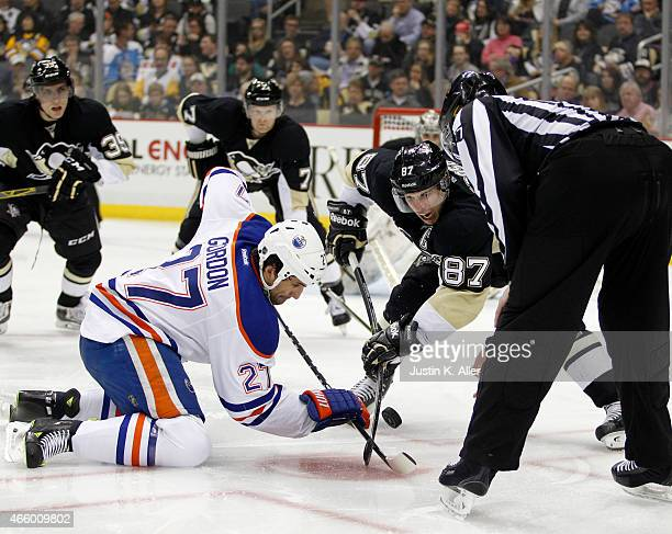 Sidney Crosby of the Pittsburgh Penguins takes a faceoff against Boyd Gordon of the Edmonton Oilers during the game at Consol Energy Center on March...