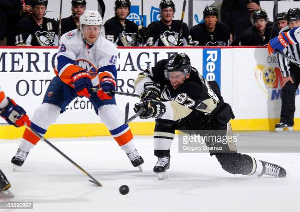 Sidney Crosby of the Pittsburgh Penguins takes a shot in front of Josh Bailey of the New York Islanders on November 21 2011 at Consol Energy Center...
