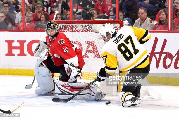 Sidney Crosby of the Pittsburgh Penguins takes a shot on Craig Anderson of the Ottawa Senators during the second period in Game Four of the Eastern...