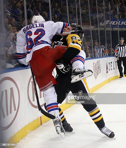 Sidney Crosby of the Pittsburgh Penguins takes an ineterference penalty during the second period against Carl Hagelin of the New York Rangers at...