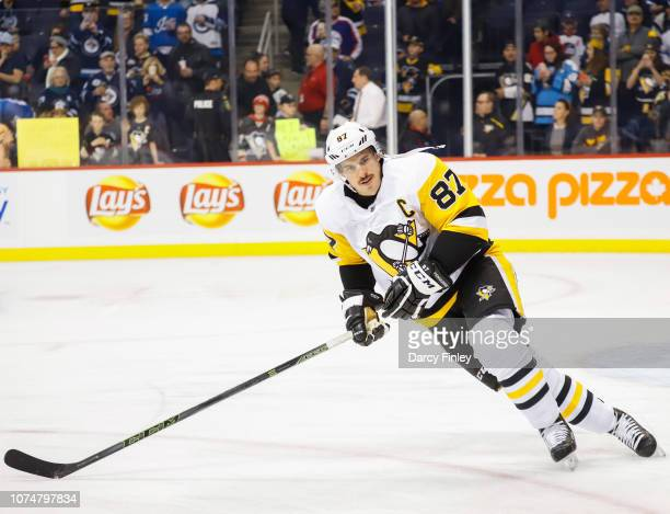 Sidney Crosby of the Pittsburgh Penguins takes part in the pregame warm up prior to NHL action against the Winnipeg Jets at the Bell MTS Place on...