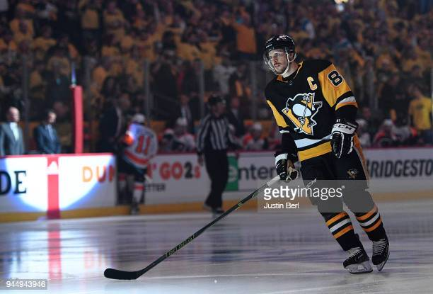 Sidney Crosby of the Pittsburgh Penguins takes the ice before the first period in Game One of the Eastern Conference First Round during the 2018 NHL...