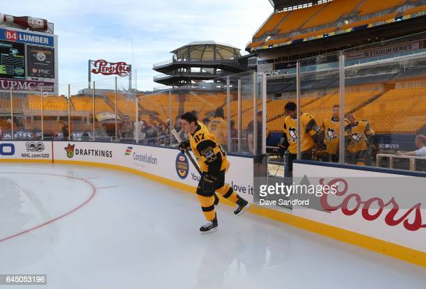 Sidney Crosby of the Pittsburgh Penguins takes the ice for a team photo prior to practice for the 2017 Coors Light NHL Stadium Series game to be...