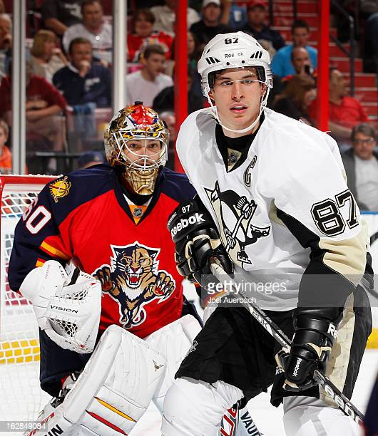 Sidney Crosby of the Pittsburgh Penguins takes up a position in front of goaltender Jose Theodore of the Florida Panthers during second period action...