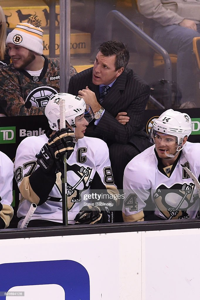 Sidney Crosby #87 of the Pittsburgh Penguins talks to his head coach Mike Sullivan during the game against the Boston Bruins at the TD Garden on December 16, 2015 in Boston, Massachusetts.