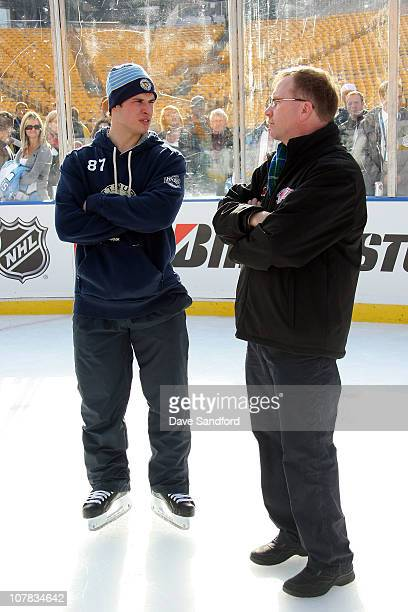 Sidney Crosby of the Pittsburgh Penguins talks with his former Coal Harbor coach Paul Mason during a family skate following practice for the 2011 NHL...