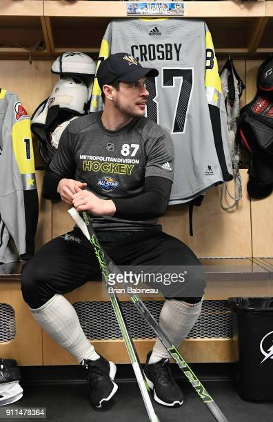 Sidney Crosby of the Pittsburgh Penguins tends to his equipment in the locker room prior to the 2018 Honda NHL AllStar Game at Amalie Arena on...