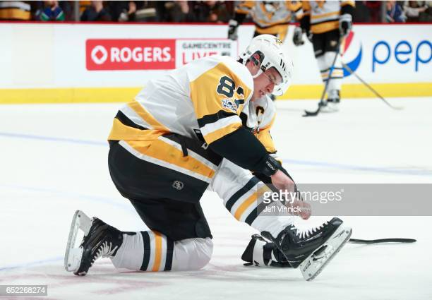 Sidney Crosby of the Pittsburgh Penguins ties his skates before his NHL game against the Vancouver Canucks at Rogers Arena March 11, 2017 in...