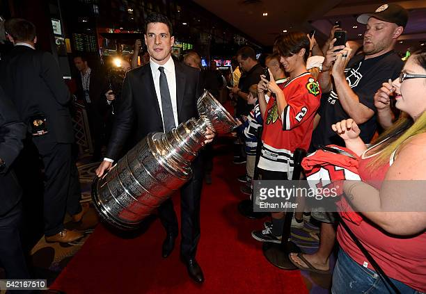 Sidney Crosby of the Pittsburgh Penguins walks in with the Stanley Cup as he attends the 2016 NHL Awards at the Hard Rock Hotel Casino on June 22...