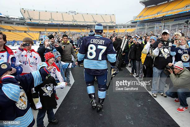Sidney Crosby of the Pittsburgh Penguins walks to the ice prior to practice for the 2011 NHL Bridgestone Winter Classic at Heinz Field on December 31...