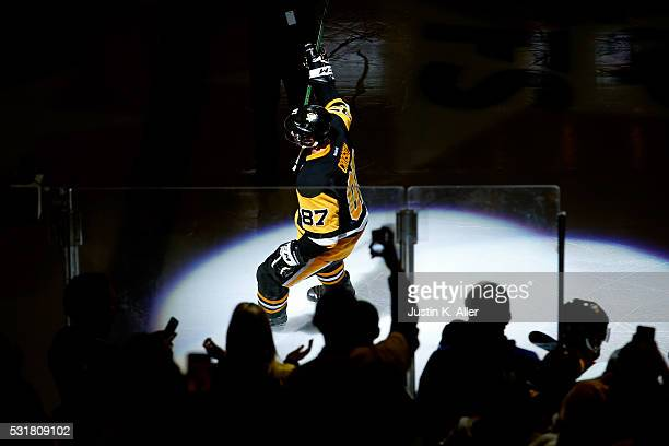 Sidney Crosby of the Pittsburgh Penguins waves to the crowd after scoring a goal in overtime against Andrei Vasilevskiy of the Tampa Bay Lightning to...