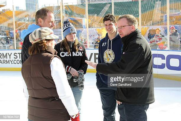 Sidney Crosby of the Pittsburgh Penguinstalks with with his father Troy mother Trina sister Taylor and his former Coal Harbor coach Paul Mason during...