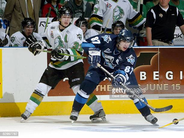 Sidney Crosby of the Rimouski Oceanic plays the puck against Brandon Prust of the London Knights during the Memorial Cup Tournament championship game...