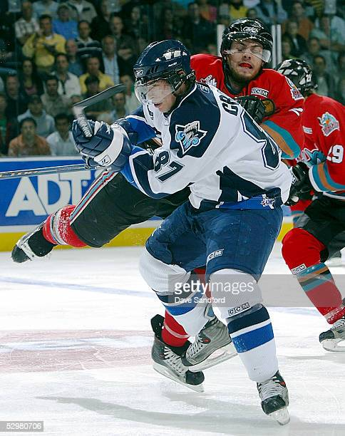 Sidney Crosby of the Rimouski Oceanic takes a hit from Shea Weber of the Kelowna Rockets during the Memorial Cup Tournament at the John Labatt Centre...