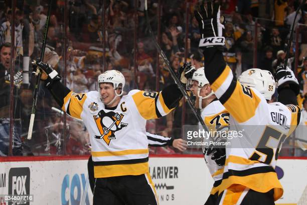 Sidney Crosby Patric Hornqvist and Jake Guentzel of the Pittsburgh Penguins celebrate after Phil Kessel scored a goal against the Arizona Coyotes...