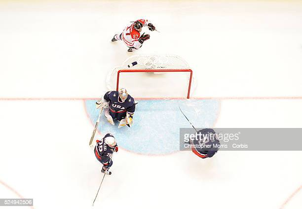 Sidney Crosby scored the overtime game winning goal against Ryan Miller during the Canada vs USA Gold medal game at Canada Hockey Place day 13 of the...