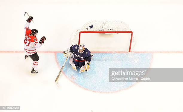 Sidney Crosby scored the overtime game winning goal against Ryan Miller during the Canada vs. USA, Gold medal game at Canada Hockey Place, day 13 of...