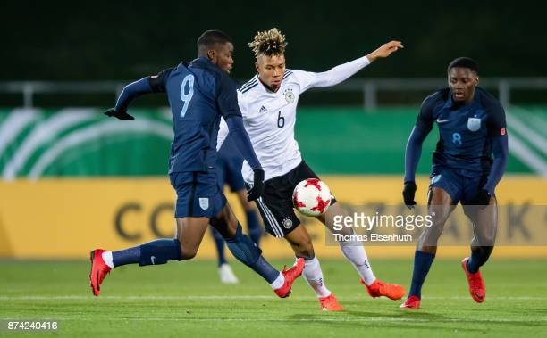 Sidney Friede of Germany and Stephy Mavididi and Joshua Da Silva of England vie for the ball during the Under 20 International Friendly match between...