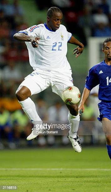 Sidney Govou of France takes control of the ball during the Confederations Cup Group A match between France and Japan on June 20 2003 at the Stade...