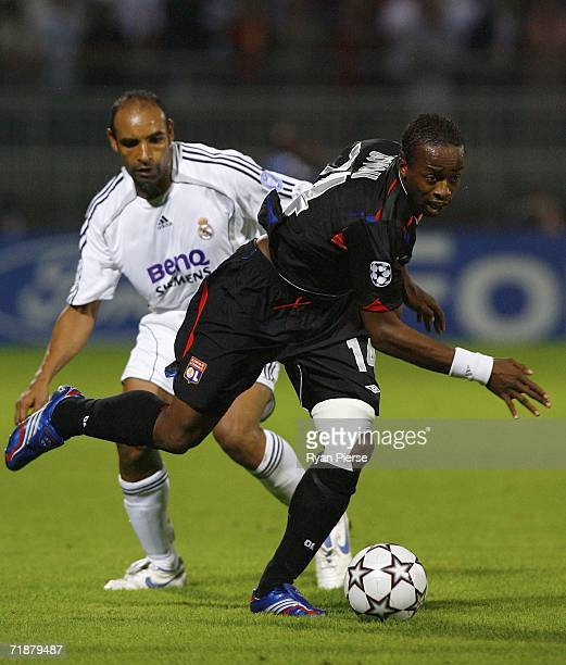 Sidney Govou of Lyon wins the ball ahead of Emerson of Real Madrid during the UEFA Champion's League Group E match between Olympique Lyonnais and...