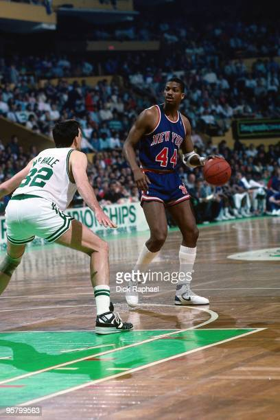 Sidney Green of the New York Knicks moves the ball up court against Kevin McHale of the Boston Celtics during a game played in 1988 at the Boston...