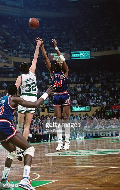 Sidney Green of the New York Knicks shoots a jump shot against Kevin McHale of the Boston Celtics during a game played in 1988 at the Boston Garden...