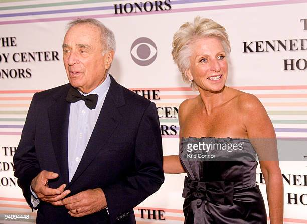 Sidney Harman and Jane Harman pose for photographers on the red carpet before the 32nd Kennedy Center Honors at Kennedy Center Hall of States on...