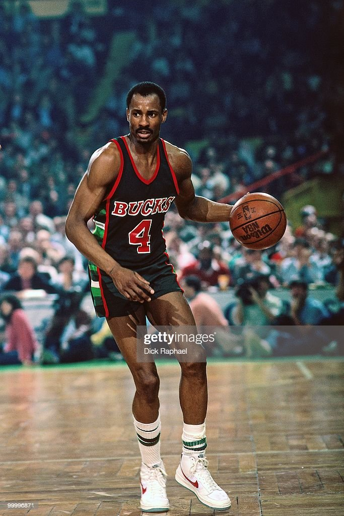 Sidney Moncrief #4 of the Milwaukee Bucks moves the ball up court against the Boston Celtics during a game played in 1983 at the Boston Garden in Boston, Massachusetts.