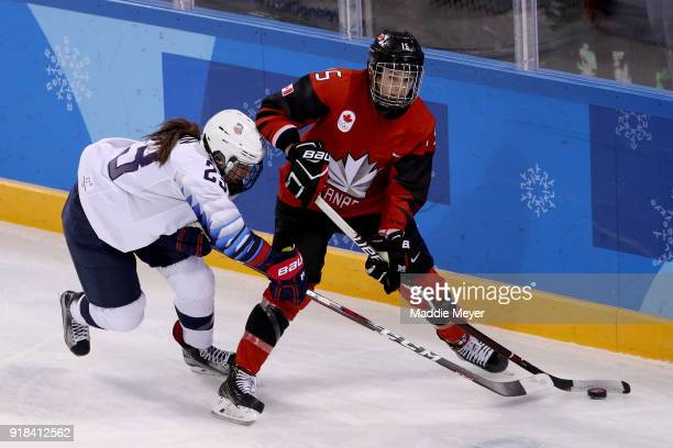 Sidney Morin of the United States and Melodie Daoust of Canada compete for the puck during the Women's Ice Hockey Preliminary Round Group A game on...