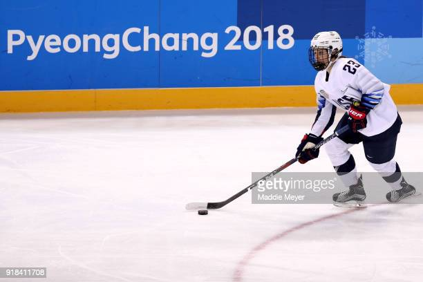 Sidney Morin of the United States handles the puck against Canada during the Women's Ice Hockey Preliminary Round Group A game on day six of the...