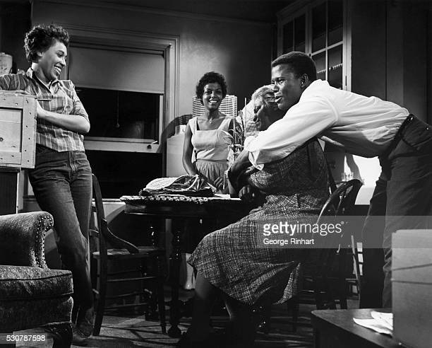 Sidney Poiter is shown embracing the character who plays his mother in the movie 'A Raisin in the Sun' Movie released in 1961