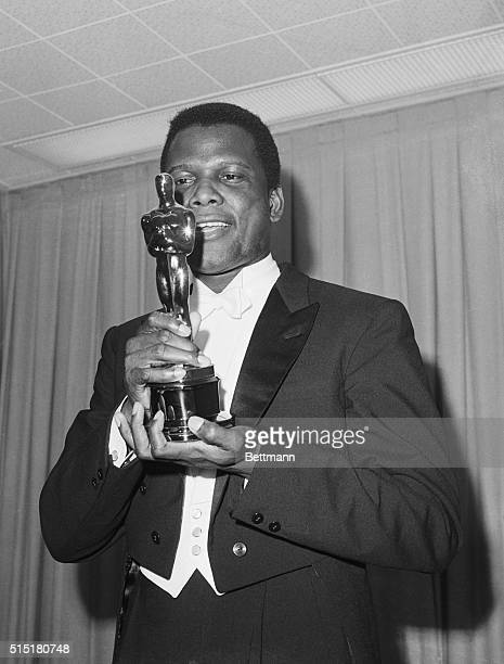 Sidney Poitier admires the Oscar he has just received in Santa Monica California on April 13 1964 He won Best Performance by an Actor for his role in...