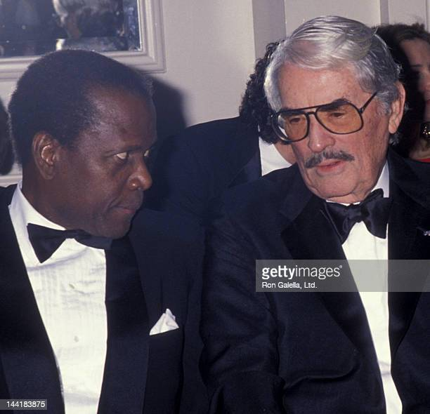 Sidney Poitier and Gregory Peck attend Sheba Humanitarian Awards Gala Honoring Liza Minnelli on January 26 1993 at the Beverly Hilton Hotel in...