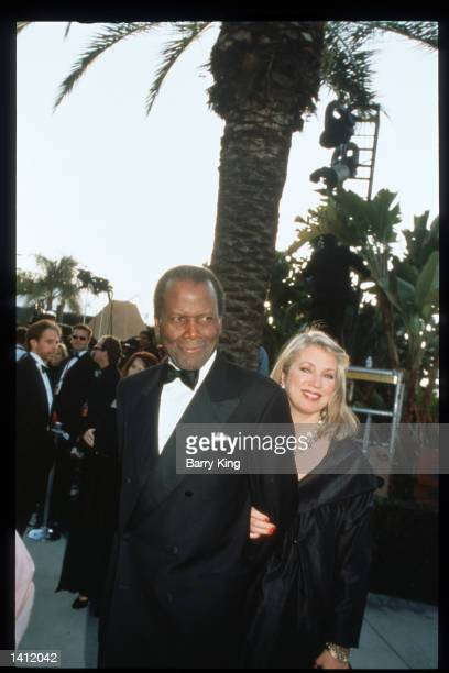 Sidney Poitier and his wife Joanna Shimkus attend the Vanity Fair Oscar party March 21, 1999 in Los Angeles, CA. The party, organized by Vanity Fair...